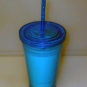Blue Plastic Cup with lid and straw.