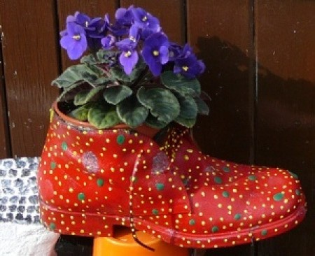 A colorfully painted boot being used as a planter.