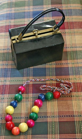 String of beads and plastic box purse.