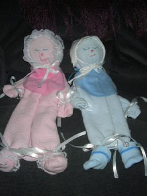 Baby blanket decorative dolls.