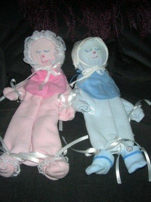Baby blanket decorative dolls.