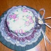 Hat shaped pin cushion holder.