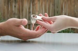 Handing Over Keys To House