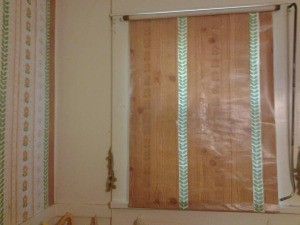 Frugal Wall Update with woodgrain vinyl.