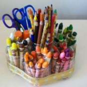 Recycled Crayon Holder With Crayons Scissors and Pencils
