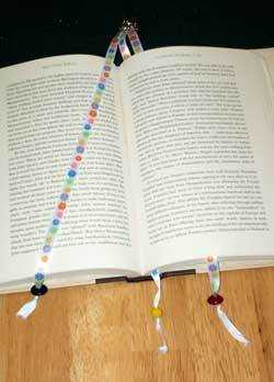 A beaded bookmark in a book.