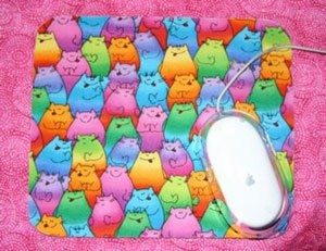 Mousepad with a cat fabric motif.