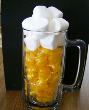 Mug with butterscotch candy in it.