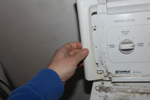 Removing plastic end cap from washing machine control panel