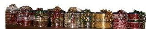 Row of decorated coffee cans.