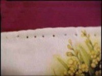 Holes in towel for crochet stiches.