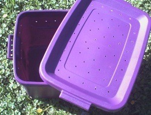 Homemade pet carrier made from a plastic tub.
