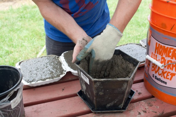 Filling Recycled Planter with Concrete