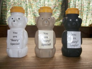 Honey bear containers painted in three colors for gifts.