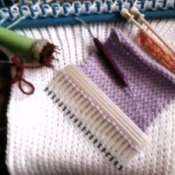 A comb being used as a pocket knitter
