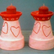 Decorated clay pot candleholders.