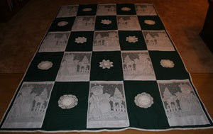 Blue and white quilt with lace panels.