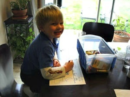 A preschooler working on his letter of the day