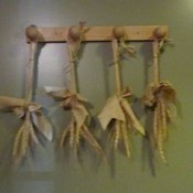 Tied stalks hanging from pegs.