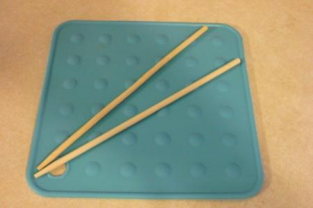 Chopsticks on silicone pot holder.