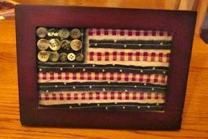 """Scrappy framed flag with button """"stars""""."""