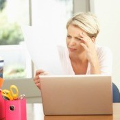 A woman paying her bills online.