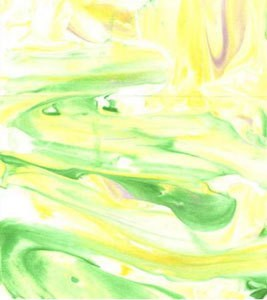 Closeup of green and yellow tie dye paper.