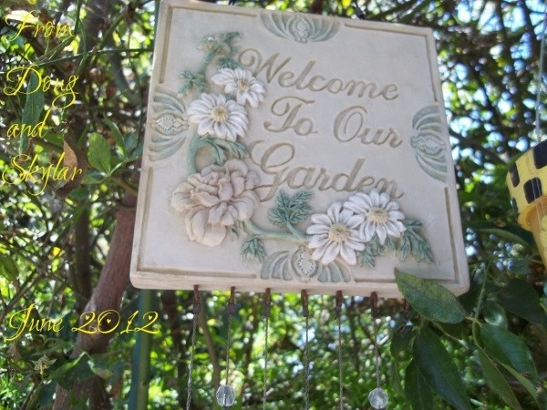 Pretty tile wind chime sign for the path garden.