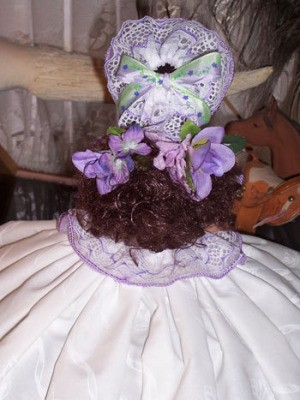 View of back of doll.