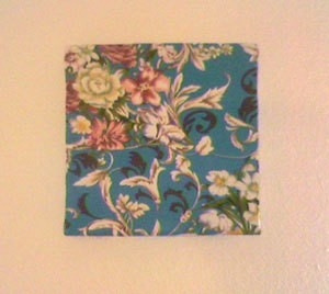 Floral fabric covered pizza box.