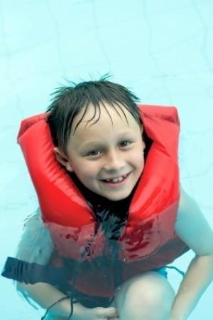 Boy in Life-vest in Swimming Pool