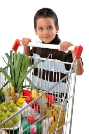 Young Boy Pushing Shopping Cart