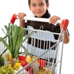 Young Boy Pushing Shopping Cart