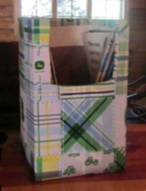 A completed magazine holder from a recycled box.