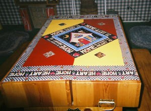 Sheet vinyl scrap decorated to be used as table cover.
