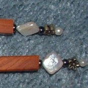 Closeup of beaded end of hair sticks.