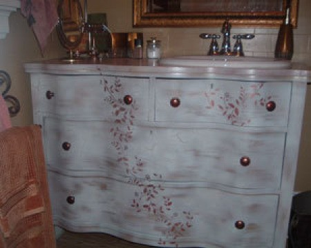 Refurbished dresser as bathroom vanity.