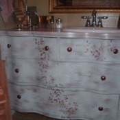 Refurbished dresser as bathroom vanity.