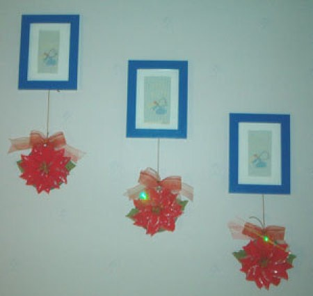 CDa with poinsettias attached as wall hangings.