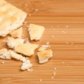 Cracker Crumbs on Wooden Cutting Board