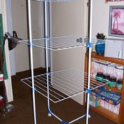 A laundry drying rack in a spare bedroom