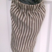 Plastic bag holder made from a shirt sleeve.