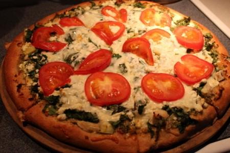 Baked pizza still on pan.