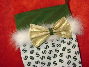 White fabric with green dollar sign print.