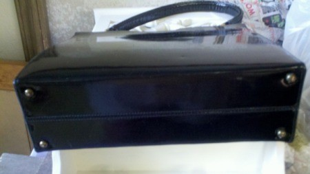 Small indentation on purse.
