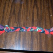 Braided Fleece Dog Toy - finished lying on a table