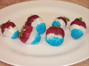 Red, white, and blue berries on a white plate.