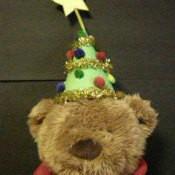 Little Christmas tree hat on stuffed bear.