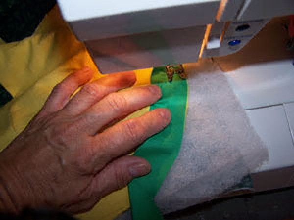Sewing on binding.