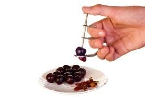 Pitting Cherries With Cherry Pitter